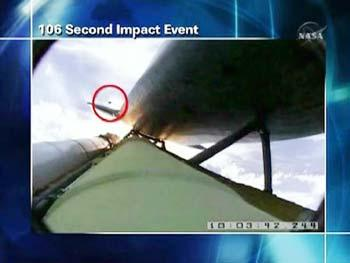 A NASA graphic shows an impact event believed responsible for damage along an area of about 21 inches (53 cm) spanning four of space shuttle Atlantis' thermal tiles in this image from NASA TV May 12, 2009. The Atlantis astronauts have uncovered a long stretch of nicks on their space shuttle, the result of launch debris. NASA says the damage does not appear to be serious. (Xinhua/Reuters Photo)