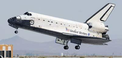 Space Shuttle Atlantis lands in the Mojave Desert at the NASA Dryden Flight Research Center on Edwards Air Force Base near Mojave, California. The space shuttle Atlantis touched down at its alternative landing spot in California Sunday after a successful mission to repair and upgrade the Hubble Telescope. (Xinhua/AFP Photo)