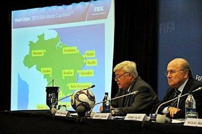 FIFA president Joseph Blatter (R) looks on as Brazilian Football Federation president Ricardo Terra Teixeira answers a question. FIFA announced 12 Brazilian cities -- Belo Horizonte, Brasilia, Cuiaba, Curitiba, Fortaleza, Manaus, Natal, Porto Alegre, Recife, Rio de Janeiro, Salvador, Sao Paulo -- which will host the 2014 World Cup.(AFP/Jewel Samad)