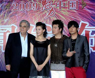 Spain tenor Placido Domingo (1st L), Chinese singer Song Zuying (2nd L), Chinese pianist Lang Lang (3rd L) and Chinese Taipei pop singer Jay Chou pose for a group photo at a press conference in Beijing, China, June 28, 2009, one day before their concert at the Bird's Nest in Beijing. (Xinhua Photo)