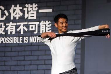 "Action star Jet Li teaches his self-developed exercise ""Wuji"" in Beijing on August 5, 2009. Star learners there included actor Peter Ho (seen in picture 3). Jet Li is working with sportswear brand Adidas in promoting new fitness concepts among urban Chinese. [Photo: yule.sohu.com]"