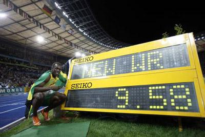 Jamaica's Usain Bolt poses with the result board after winning the men's 100m final race of the 2009 IAAF Athletics World Championships in Berlin, Germany, on Aug. 16, 2009. Bolt set a new world record with a time of 9.58 seconds and claimed the title of the event.