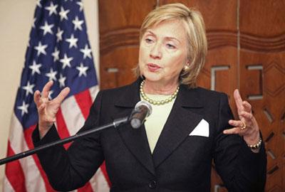 U.S. Secretary of State Hillary Clinton speaks to the media during a visit to the Foreign Minister's Residence in Abuja August 12, 2009.(Xinhua/Reuters Photo)