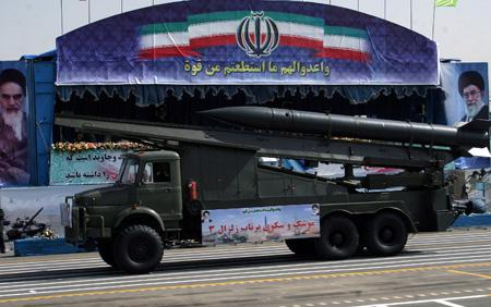 A missile truck is displayed during an annual military parade which marks the 29th anniversary of Iran's eight-year war with Iraq, in Tehran on Sept. 22, 2009. Iranian President Mahmoud Ahmadinejad warned that Iran would confront any attack on the Islamic republic on Tuesday. (Xinhua/Ahmad Halabisaz)