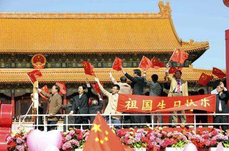 A float takes part in a parade of the celebrations for the 60th anniversary of the founding of the People's Republic of China, on Chang'an Street in central Beijing, capital of China, Oct. 1, 2009. (Xinhua/Li Tao)
